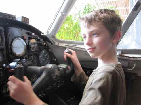 Z in the cockpit of an Antonov plane at Airport discotheque, Sihanoukville, Cambodia