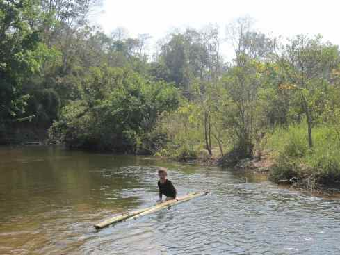 building a bamboo raft in Virachey National Park