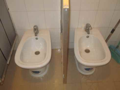 bizarre doorless bidet setup-up, bao lao border, vietnam-laos