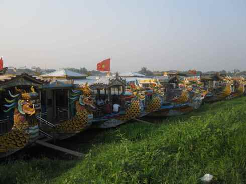 Dragon boats moored on the Perfume River, Hue, Vietnam.
