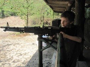 Z takes aim with an M60, Cu Chi Tunnels