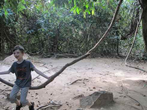 Swinging on a jungle vine, Kbal Spean, Cambodia