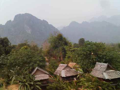 View of huts and karsts, Vang Vieng, Laos