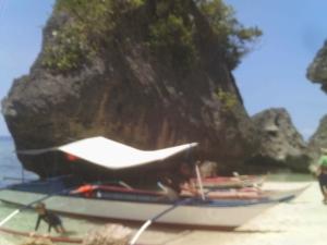 Banca (outrigger) moored on beach, Gaspar Island, Marinduque, Philippines