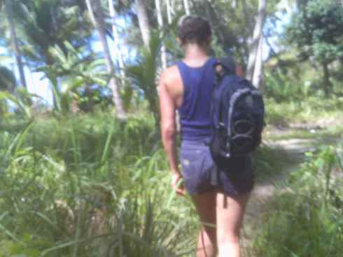 Me from behind, walking through coconut forest, Mariquit, Palawan, Philippines