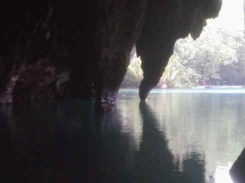 View from the Puerto Princesa Underground River, Palawan, Philippines: jagged rock and turquoise water.