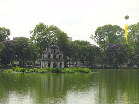 Balloons and the iconic pagoda in Hoan Kiem Lake, Hanoi, Vietnam