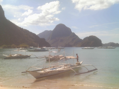 view of bangkas and islands in El Nido bay.