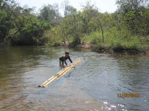 In the water, making a bamboo raft in Virachey National Park, Cambodia
