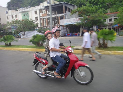 Z riding a xe om, or motorbike taxi, Vietnam