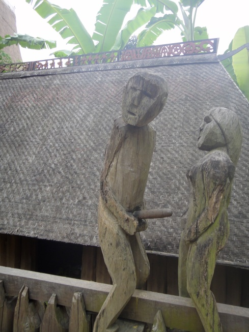 sexual wood carving of man and woman on tribal tomb, Museum of Ethnography, Hanoi, Vietnam.