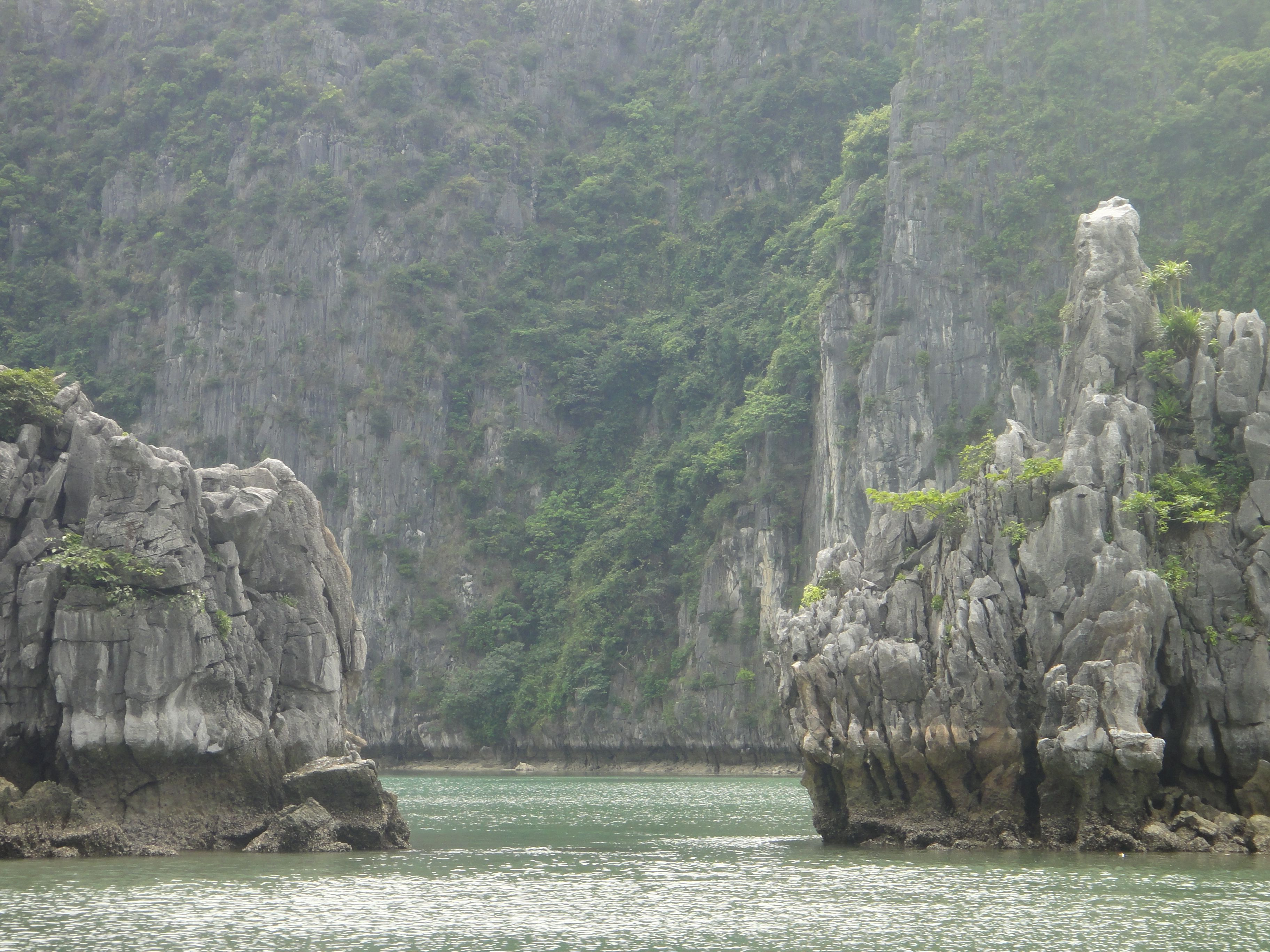 View of cliffs between twin pillars, Halong Bay, Vietnam.