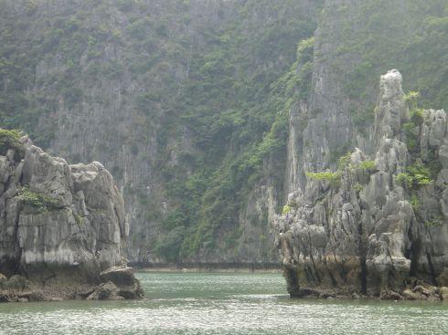 View of cliffs between twin pillars, Halong Bay, Vietnam.
