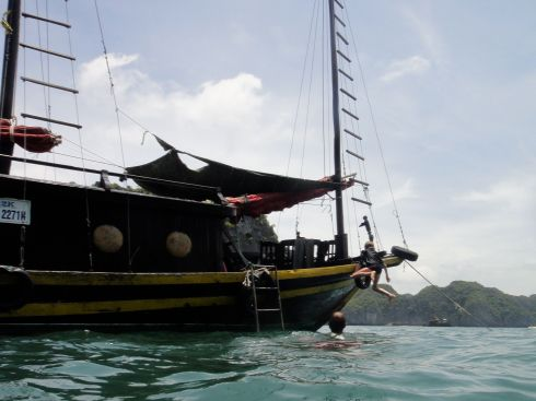 Z in midflight from the deck of a junk, Halong Bay, Vietnam.