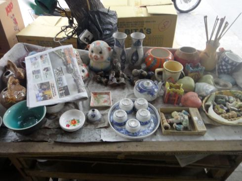 Table with pottery outside an art store/stationers, Hanoi, Vietnam.