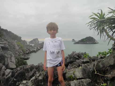 Z on ridge of Monkey Island, with islets in the distance, Halong Bay, Vietnam.