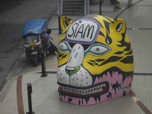 Pink and yellow leopard's head with tuk-tuk, Bangkok