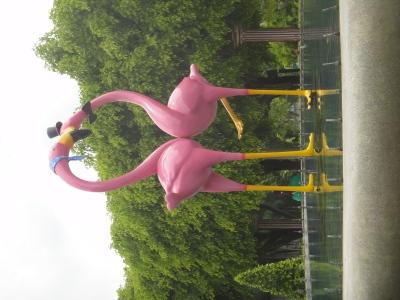 PLastic pink flamingoes intertwined at Dreamworld, Bangkok.
