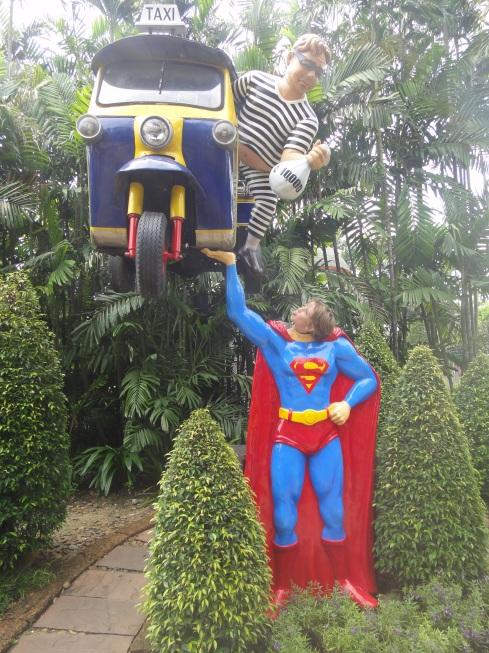 Posing for a photo as Superman lifting a tuk-tuk, Dreamworld, Bangkok.