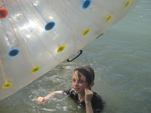 Z in lake, underneath brightly coloured zorb ball.