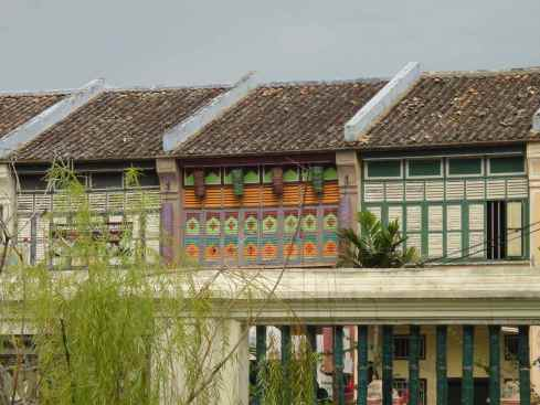 the brightly coloured second storey of the shop houses which were Cheong Fatt Tze's servants' quarters.