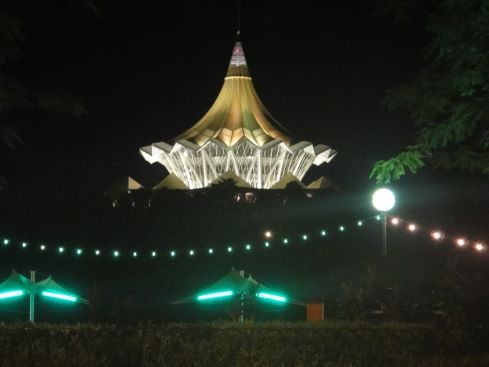 The space age State Assembly building in Kuching, Sarawak, Borneo, its golden, tented top illuminated by night.