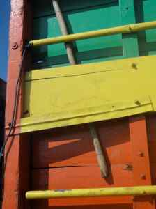 Back of lorry in red, green and yellow. Makassar Port, indonesia.