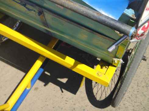 Rear of rickshaw carriage in green and gold. Makassar, Indonesia.