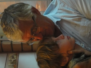 Z having a cuddle with his grandfather on his grandparents' last night in Borneo.