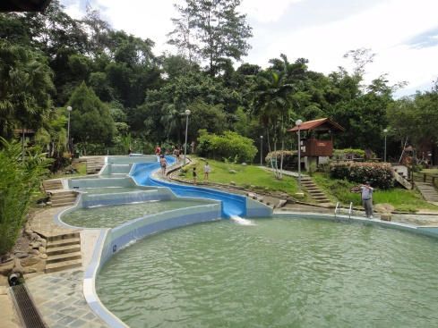 stepped pools and waterslide against verdant backdrop of lowland forest. Poring Hot Springs, Kinabalu Park, Borneo, Malaysia.