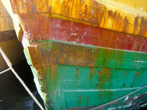 Striped hull of Bugis sailing ship, Makassar port, Indonesia.