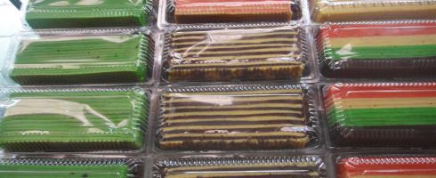 Brightly coloured stripey cakes for sale in Borneo.