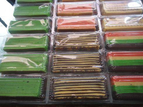 Brightly coloured stripey cakes for sale in Borneo.