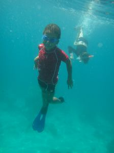 Two small boys snorkelling in search of a turtle, Pulau Derawan.