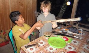 Amal shows Z the toy gun he has made. Pulau Kadidiri, Indonesia.