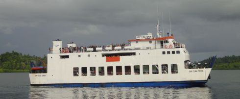 ferry pulls into wakai, togian islands, sulawesi, indonesia.