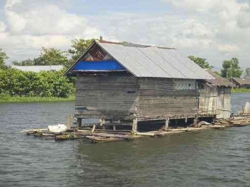 Floating house on bamboo raft, Danau Tempe lake, Sulawesi, Indonesia.