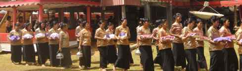 Procession of female mourners at Torajan funeral. Sulawesi, Indonesia.