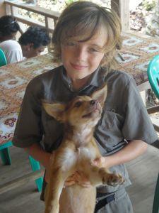 Z holding compliant puppy, Pulau Kadidiri, indonesia.