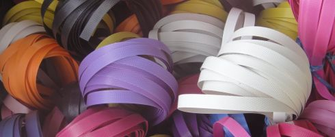 brightly coloured rolls of packing tape
