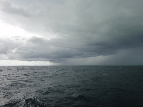 storm incoming over calm sea between sulawesi and maluku
