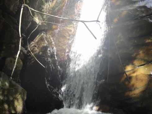 foaming waterfall illuminated in bright light, borneo