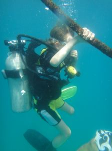 descending in full scuba gear down a rope in Koh Tao, Thailand.