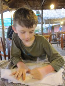 sitting doing maths in a cafe in thailand.
