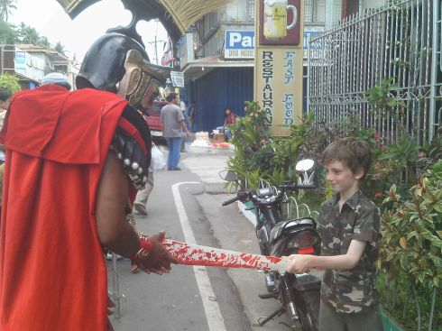 duelling with a masked man dressed as a Roman centurion during the Moriones festival in Marinduque