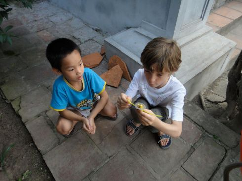 playing beyblades in the Temple of Literature, Hanoi, Vietnam
