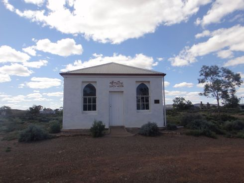 Repainted but abandoned grocers turned chapel in Beltana, South Australia.