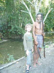 With Mr Luobo, a Togutil tribesperson in loincloth and spear, in the jungles of Halmahera, Indonesia.